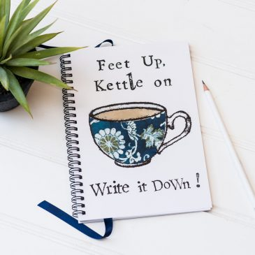 Feet Up Kettle On Notebook