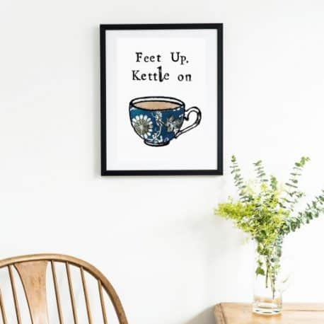 feet up kettle on print on the wall